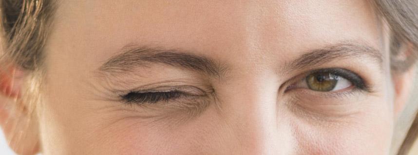 Portrait of woman blinking